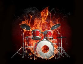 Drums and the skeleton of a man burn in flames
