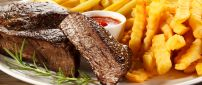 Beef and fries with red sauce