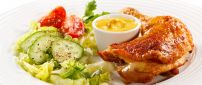 Chicken drumstick with sauce and salad