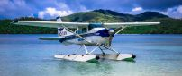 A white seaplanes was landed on water
