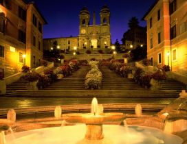 The fountain in front of the Spanish Steps in Rome
