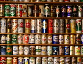 A wall of different brands of beer cans