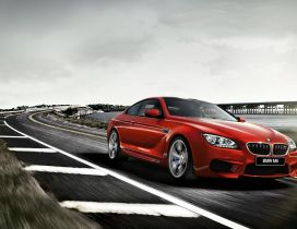 Red BMW M6 F13 Coupe on road - Gorgeous car