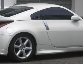 White Nissan 350Z in the parking