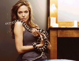 Angelina Jolie with a white with black snake