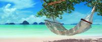 Relaxing hammock on the beautiful blue water