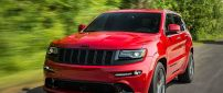 Red Jeep Grand Cherokee SRT8 on road