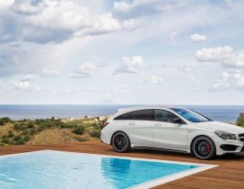White Mercedes CLA 45 AMG near a pool