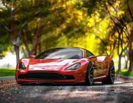 Red Aston Martin DBC Superb in a park