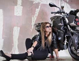 A black girl near the black BMW F800 R Predator
