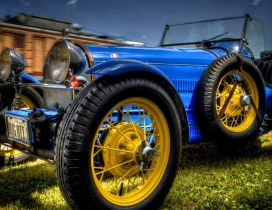 Blue and vintage Bugatti type 37 with yellow wheels