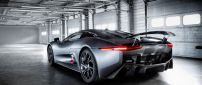 Gray Jaguar C-X75 Hybrid in garage - Back view car