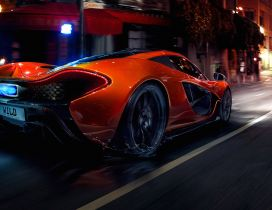 Orange McLaren P1 Hypercar in the city