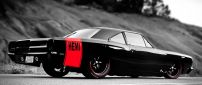 Beautiful black Hemi car on road