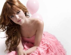 The actress Bella Thorne in a pink dress
