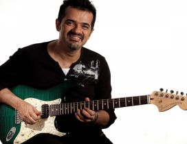 Ehsaan Noorani in black with his quitar