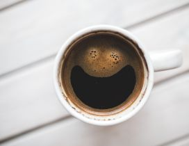 Big smile in a cup of coffee - Happy morning day