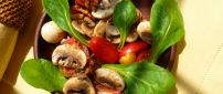 Delicious salad with mushrooms tomatoes and spinach