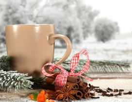 Cream colored coffee cup and cinnamon - Christmas moments