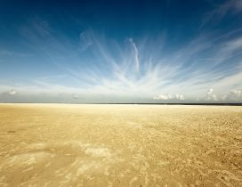 Golden sand in the desert - Wonderful clouds on the blue sky