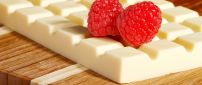 White chocolate bar and two delicious raspberry fruits