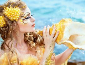 Beautiful golden mermaid and shell - Professional makeup