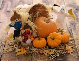 Funny scarecrow and Halloween pumpkins
