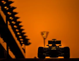 Formula 1 race car in the light of orange sunset