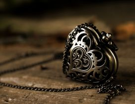 Heart pendant on a wooden table - HD wallpaper