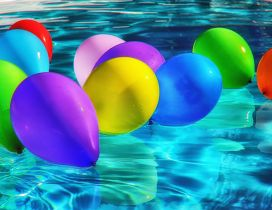Party all day - Colorful balloons in the pool