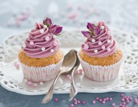 Two delicious muffins with pink cream - Flower for love