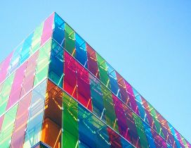 Big architectural building with colourful glass walls