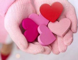 Painted wooden hearts on my hand - Love  red pink colors