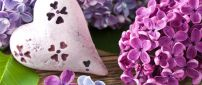 Painted Lilac flowers on a stone in shape of heart