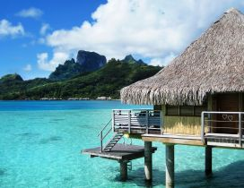 Small traditional house on the water-Bora Bora Tahiti Island