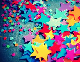 Paper colorful little stars on the wall - HD wallpaper