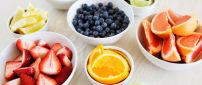 Delicious summer fruits in white cups - Vitamin color meal