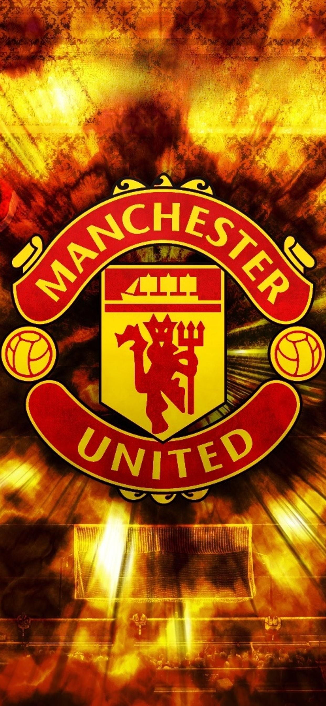 Manchester United Inscription And Football Background